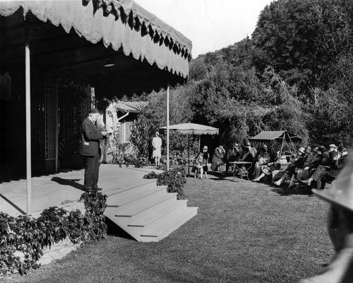 Henry Mead Bland gives a presentation at the Garden Theatre, 1923