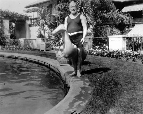 Senator Phelan with a peculiar rubber duck, near the Oval Garden pool
