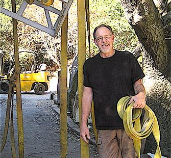 David Middlebrook poses with his sculpture, Haywire
