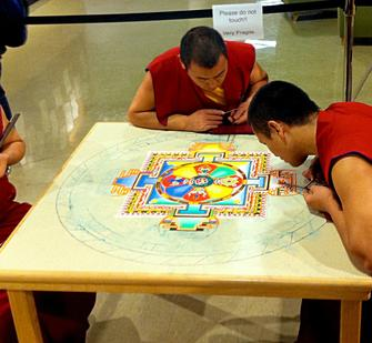 Tibetan monks working on the Sand Mandala