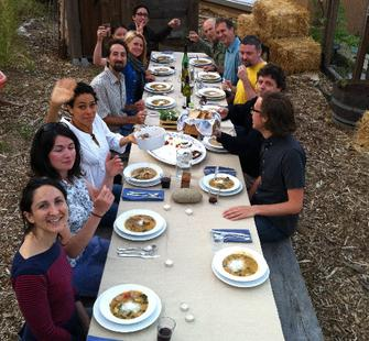The artists in residence eat together at a communal table.