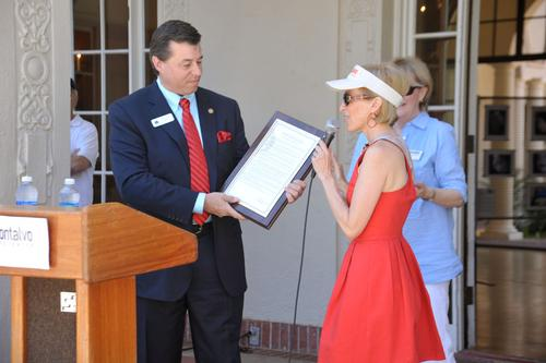 Angela receives an honor from Mayor Chuck Page