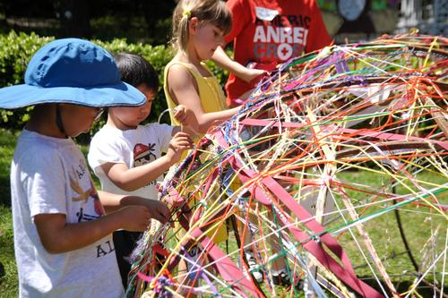 Kids add ribbon at Arts Splash