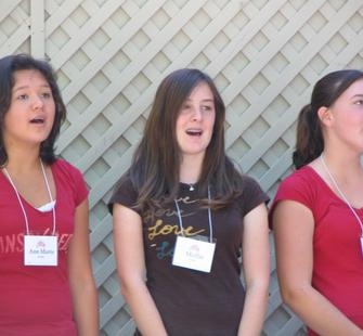 Young women singing their number.