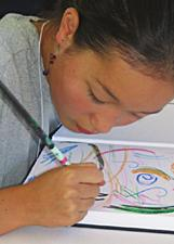 A young artist works on a drawing
