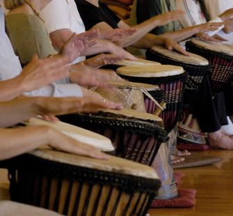 Drumming together.