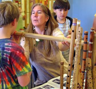 Students and teacher working on bamboo flutes