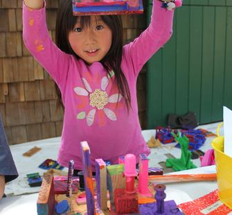 A young artist shows off her masterpiece!