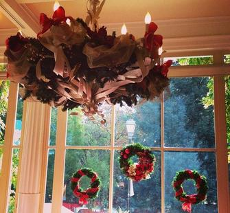 Yuletide wreaths in the window of the Villa