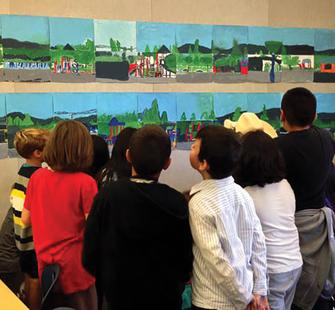 Students and their classroom artwork